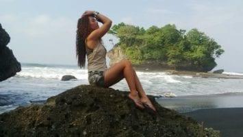 beautiful girl on a rock