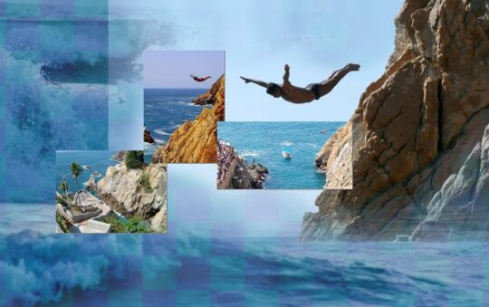 Jumping from the top of the cliff in Acapulco, Mexico